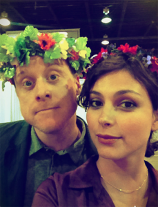 Alan Tudyk and Morena Baccarin wearing flower crowns